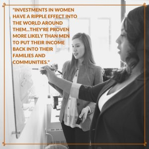 Invest in Women - Photo of two women collaborating in a business setting with quote about how investments in women have a ripple effect